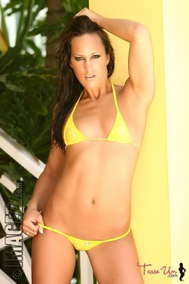 Alicia Puckey in a sexy yellow tiny bikini