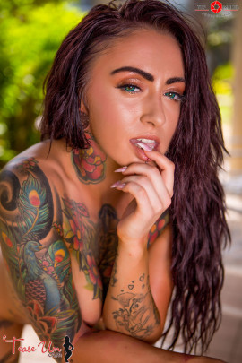 teaseum model trixie nude body covered in tattoos