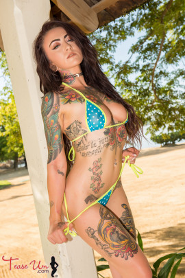 teaseum model trixie showing off her tattooed body