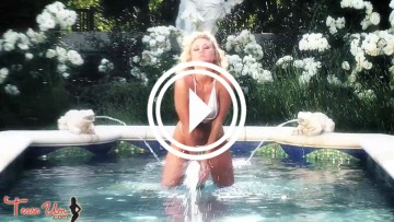 Amanda Nicole playing in the fountain.