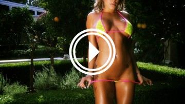 Courtney Soucy busty bikini topless video screen.