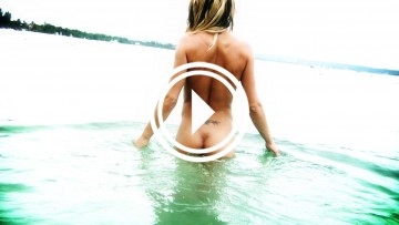 Sexy shot of Melyssa Buhl naked in the ocean.